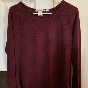 Long sleeve maroon shirt with small cutouts
